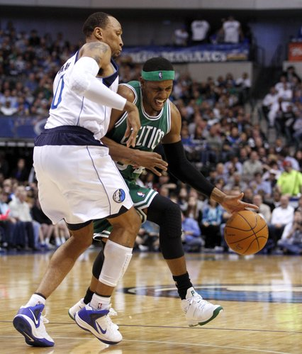 Boston Celtics forward Paul Pierce (34) drives toward the basket against Dallas Mavericks forward Shawn Marion (0) during the first half of an NBA basketball game in Dallas, Monday, Feb. 20, 2012.