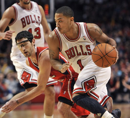 Chicago Bulls guard Derrick Rose, right, drives past Atlanta Hawks guard Kirk Hinrich during the fourth quarter of an NBA basketball game, Monday, Feb. 20, 2012 in Chicago. The Bulls won 90-79.