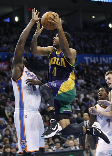 New Orleans Hornets guard Xavier Henry (4) goes up for a shot in front of Oklahoma City Thunder center Nazr Mohammed (8) in the second quarter of an NBA basketball game in Oklahoma City, Monday, Feb. 20, 2012.