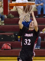 Lawrence High's Logan Henrichs finishes at the rim during Lawrence High's game against Shawnee Mission North Tuesday, Feb. 21, 2012, in Overland Park.