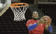 Kansas forward Thomas Robinson goes up for a reverse dunk during warmups before the Jayhawks' road game against Texas A&M on Wednesday, Feb. 22, 2012,  in College Station, Texas.