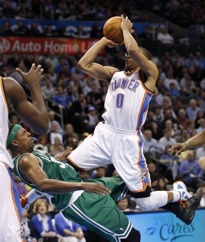 Oklahoma City Thunder guard Russell Westbrook (0) collides with Boston Celtics forward Paul Pierce (34) on a shot during the third quarter of an NBA basketball game in Oklahoma City, Wednesday, Feb. 22, 2012. Oklahoma City won 119-104.
