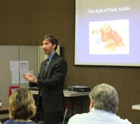Stephen Ilardi talks about his clinical research on depression during a program Thursday, Feb. 23, 2012, at the Lawrence Senior Center.