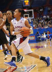 Kansas guard Angel Goodrich drives by Baylor's Odyssey Sims during Friday's game at Allen Fieldhouse.