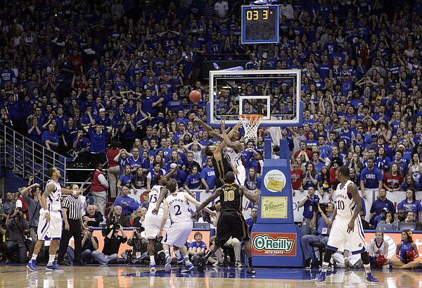 Thomas Robinson (0) blocks the Tigers Phil Pressey's shot with 3.3 seconds in regulation to force the game into overtime. The Jayhawks won the game 87-86 against the Missouri Tigers, Saturday, Feb 25, 2012..