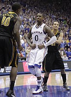 Thomas Robinson (0) looks at Ricardo Ratliffe (10) after Robinson made a layup to bring the Jayhawks within one point of the Tigers with  two and a half minutes left in regulation. The Jayhawks went on to win 87-86 against the Missouri Tigers, Saturday, Feb 25, 2012..