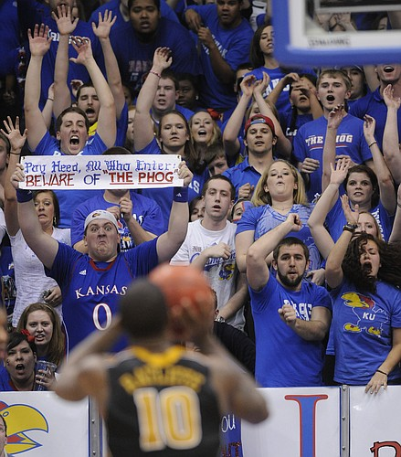 KU fans try to disrupt a free-throw attempt by the Tiger's Ricardo Ratliffein the Jayhawks win against the Missouri Tigers, Saturday, Feb 25, 2012..