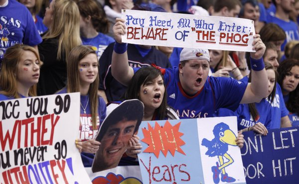 Kansas University students Vanessa Phillips, Wichita senior, and Josh Deboer, Overland Park senior, scowl at the Missouri players as they take the court  prior to tipoff on Saturday, Feb. 25, 2012 at Allen Fieldhouse.