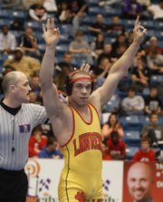Lawrence High's Reece Wright-Conklin celebrates after defeating Manhattan High's Trey Campbell in the Class 6A 182-pound finals on Saturday, Feb. 25, 2012, in Wichita.