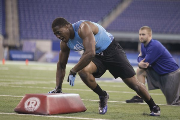 Kansas linebacker Steven Johnson runs a drill at the NFL football scouting combine in Indianapolis, Monday, Feb. 27, 2012.