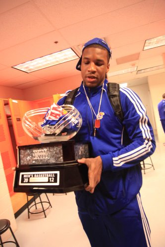 Kansas forward Thomas Robinson carries out the Big 12 Trophy after KU defeated Oklahoma State, 70-58, on Monday, Feb. 25, 2012, at Gallagher-Iba Arena in Stillwater, Okla.