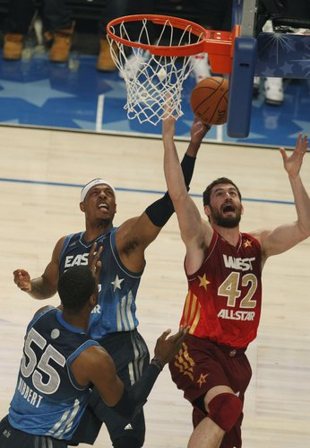 Western Conference's Kevin Love (42), of the Minnesota Timberwolves and Eastern Conference All-Star Paul Pierce (34), of the Boston Celtics go after a rebound, during the first half of the NBA All-Star basketball game, Sunday, Feb. 26, 2012 in Orlando, Fla.