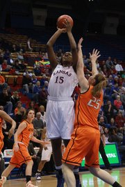 Kansas' Chelsea Gardner goes up against Oklahoma State's Lindsey Keller on Wednesday night at Allen Fieldhouse.
