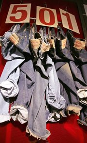"A Levi's 501 jean display is seen at the flagship store Oct. 11, 2005, in San Francisco. These days, our country's (arguably) best-dressed men can often be spotted wearing field jackets, chambray work-shirts, duck canvas pants, selvedge denim and tweed. It's clothing you might have expected to see on farms and in factories, or even ""when you were younger."""