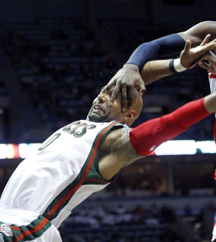 Milwaukee Bucks' Drew Gooden is fouled by Washington Wizards' Chris Singleton during the first half of an NBA basketball game, Tuesday, Feb. 28, 2012, in Milwaukee.