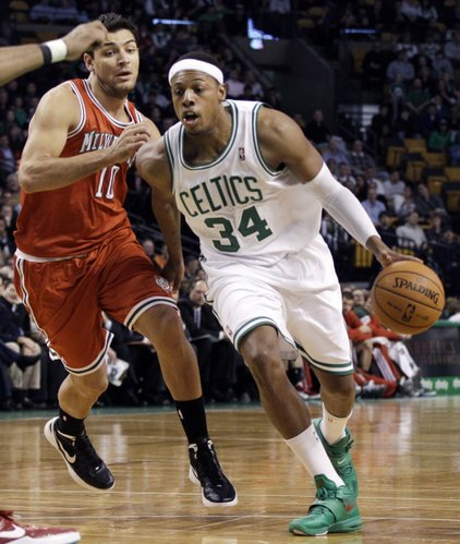 Boston Celtics forward Paul Pierce (34) drives past Milwaukee Bucks forward Carlos Delfino (10) during the first half of an NBA basketball game in Boston Wednesday, Feb. 29, 2012.