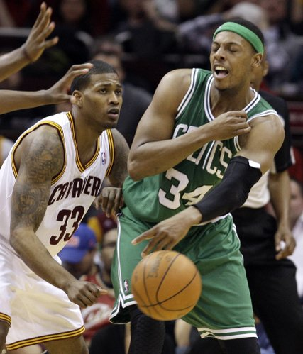 Boston Celtics' Paul Pierce (34) passes the ball past Cleveland Cavaliers' Alonzo Gee (33) in the fourth quarter in an NBA basketball game Tuesday, Feb. 28, 2012, in Cleveland. The Celtics won 86-83.