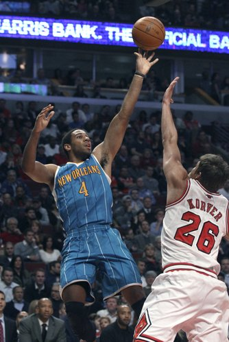 New Orleans Hornets guard Xavier Henry (4) shoots over Chicago Bulls forward Kyle Korver during the first half of an NBA basketball game Tuesday, Feb. 28, 2012, in Chicago.