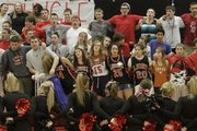 Lawrence High school students sway as they sing the school Alma Mater before a sub-state home game against Olathe East on Thursday, March 1, 2012.