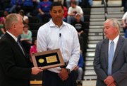 Leavenworth graduate and former Kansas University player Wayne Simiem, Jr., center, was inducted in the Kansas State High School Activities Association Hall of Fame before a sub-state game Thursday at Leavenworth.