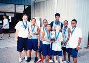 Eleven-year-old Tyshawn Taylor, second from right, is shown with his Prime Time AAU team in this 2001 photo. At right is Prime Time coach Stephanie Crawford.