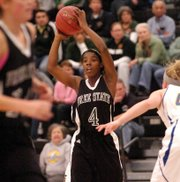 Free State High's Aliyah Rogers looks for a teammate as Free State girls played Olathe South in second round of sub-state on Friday, Mar. 2, 2012, in Leavenworth. Free State lost, 60-48.
