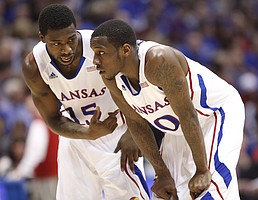 Kansas guards Tyshawn Taylor (10) and Elijah Johnson go over a gameplan against Texas during the first half on Saturday, March 3, 2012 at Allen Fieldhouse.