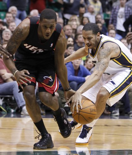 Miami Heat's Mario Chalmers, left, has the ball stolen by Utah Jazz's Devin Harris during the first half of an NBA basketball game in Salt Lake City, Friday, March 2, 2012.