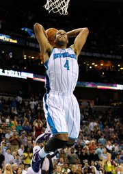 New Orleans Hornets shooting guard Xavier Henry (4) dunks the ball during the second half of an NBA basketball game against the Dallas Mavericks in New Orleans, Friday, March 2, 2012. The Hornets won 97-92.
