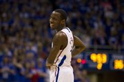 Kansas senior guard Tyshawn Taylor (10) flashes a smile during the second half Saturday, March 3, 2012 at Allen Fieldhouse.