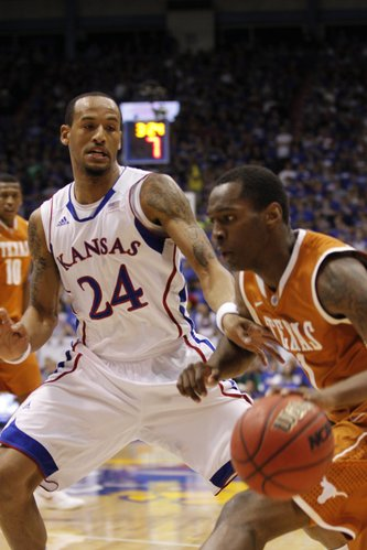 Kansas' Travis Releford (24) applies defensive pressure to Texas' Sheldon McCellan (1) during the first half Saturday, March 3, 2012 at Allen Fieldhouse.