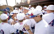 The Jayhawks jump around in the dugout to get pumped up for their home opener against North Dakota, Tuesday, March 6, 2012 at Hoglund Ballpark.
