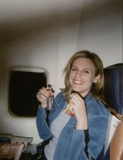 Louise Krug on an airplane to Jamaica in 2004.