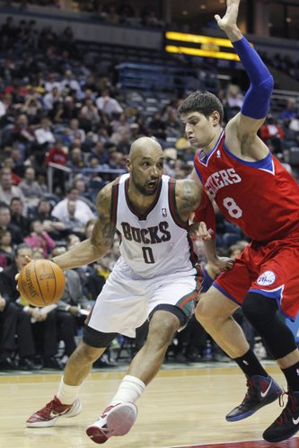 Milwaukee Bucks' Drew Gooden(0) drives against Philadelphia 76ers' Nikola Vucevic(8) in the second half of an NBA basketball game Monday, March. 5, 2012, in Milwaukee.