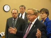 Legislators on Wednesday urge Gov. Sam Brownback to delay implementation of Medicaid reform. In foreground from left to right are state Sens. Anthony Hensley, D-Topeka, and Dick Kelsey, R-Goddard. In the background are state Rep. Bob Bethel, R-Alden, and state Sen. Laura Kelly, D-Topeka.