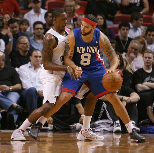 New York Knicks' Deron Williams drives against Miami Heat's Mario Chalmers during the first quarter of an NBA basketball game Tuesday, March 6, 2012, in Miami. The Heat won 108-78.