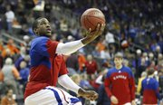 Kansas forward Thomas Robinson elevates for a layup prior to tipoff against Texas A&M on Thursday, March 8, 2012 during the Big 12 Tournament.