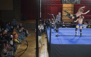 "The crowd watches a bout between ""Showtime"" Bradley Charles and ""Rock 'n' Roll"" Mike Sydal during a recent Saturday night Metro Pro Wrestling match at Turner Recreation Center in Kansas City, Kan."