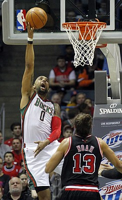 Milwaukee Bucks' Drew Gooden (0) puts up a shot against Chicago Bulls' Joakim Noah (13) during the first half of an NBA basketball game, Wednesday, March 7, 2012, in Milwaukee.