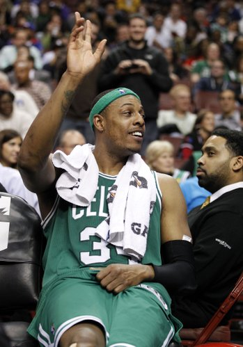 Boston Celtics forward Paul Pierce (34) waves from the bench to the fans during the second half of an NBA basketball game with the Philadelphia 76ers Wednesday, March 7, 2012 in Philadelphia. The 76ers won 103-71.