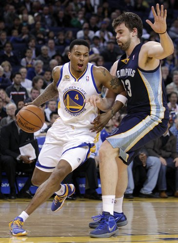 Golden State Warriors' Brandon Rush (4) drives past Memphis Grizzlies' Marc Gasol (33) during the first half of an NBA basketball game Wednesday, March 7, 2012, in Oakland, Calif.