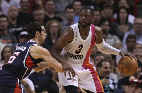 Atlanta Hawks' Kirk Hinrich (6) guards Miami Heat's Dwyane Wade (3) during the second half of an NBA basketball game in Miami, Wednesday, March 7, 2012. The Heat defeated the Hawks 89-86.