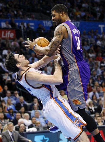 Oklahoma City Thunder center Nick Collison, left, fouls Phoenix Suns forward Markieff Morris during the second quarter of an NBA basketball game in Oklahoma City, Wednesday, March 7, 2012.