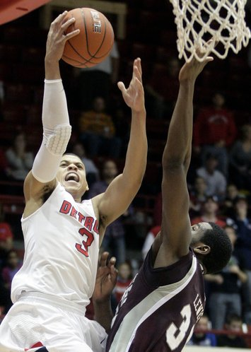 Detroit guard Ray McCallum (3) goes to the basket against Mississippi State center Wendell Lewis, right, in the second half on Saturday, Dec. 17, 2011, in Detroit.