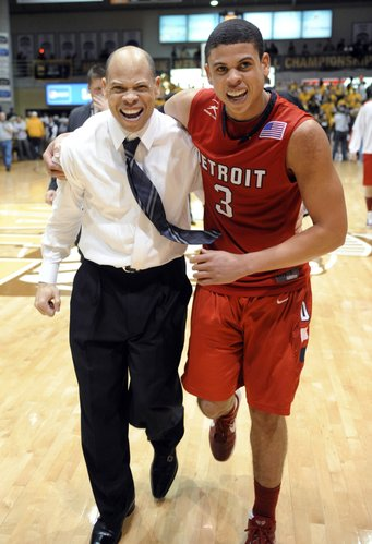 Detroit coach Ray McCallum, left, celebrates with his son and guard Ray McCallum Jr. following the team's 70-50 victory over Valparaiso in the Horizon League men's tournament title game on Tuesday, March 6, 2012, in Valparaiso, Ind.