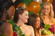 Cassie Weatherwax, second from left, and other candidates pose for photographs after Weatherwax was named the 2012 St. Patrick's Day Parade queen during a ceremony at the Flamingo Club in North Lawrence on Sunday. Weatherwax said this would be her 12th year participating in the parade.