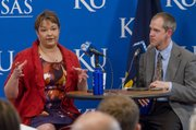 ENVIRONMENTAL PROTECTION AGENCY ADMINISTRATOR LISA JACKSON speaks at a forum with Chris Brown, a professor in Kansas University's environmental studies program, Monday at KU's Spooner Hall.