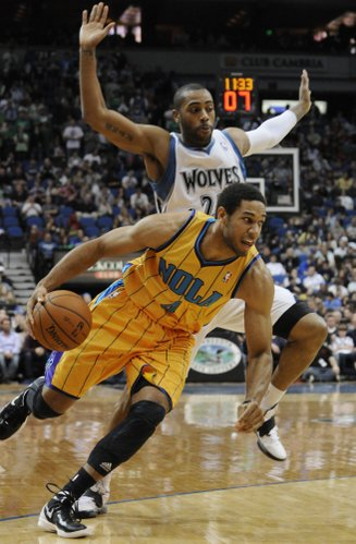 Minnesota Timberwolves' Wayne Ellington, top, and New Orleans Hornets' Xavier Henry in the second half of an NBA basketball game Saturday, March 10, 2012, in Minneapolis. The Hornets won 95-89.