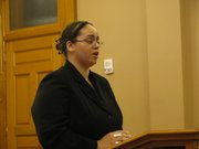 Tosha Jansen-Conkey speaks Monday during a news conference. The mother of two young boys, Jansen-Conkey spoke against attempts to eliminate the Earned Income Tax Credit.