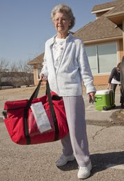 Carolyn Landgrebe, a former first-grade and reading teacher now volunteers in school, at LINK and she delivers Meals on Wheels. Landgrebe was heading out on a delivery for Meals on Wheels, Monday, March 12, 2012.